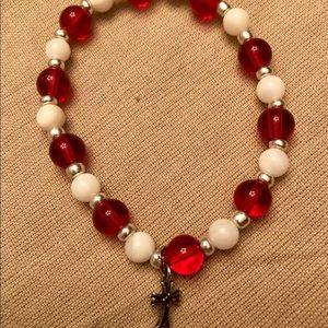 Red and white bracelet, cross